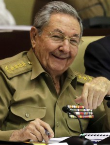 "Cuba's President Raul Castro smiles during a twice-annual legislative session at the National Assembly in Havana, Cuba, Friday, Dec. 19, 2014. When the leaders of the U.S. and Cuba had their first phone conversation in more than 50 years, they were not at a loss for words. As President Barack Obama told the story at his news conference Friday, he opened his call with Cuban President Raul Castro _ brother of famously longwinded Fidel _ with a 15-minute monologue, then apologized for taking so much time. ""He said, 'Don't worry about it, Mr. President,fh Obama related. gfYou're still a young man, and you have still the chance to break Fidel's record. He once spoke seven hours straight.""  (AP Photo/Ismael Francisco, Cubadebate)"