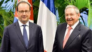 Hollande y Raúl Castro